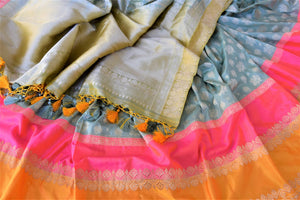 Buy beautiful sea green zari work Banarasi silk saree online in USA with pink and orange border. For Indian women in USA, Pure Elegance Indian fashion store brings an exquisite collection Banarasi sarees, Banarasi silk sarees, tussar sarees, zari work sarees, pure silk sarees all under one roof. Shop online now.-details