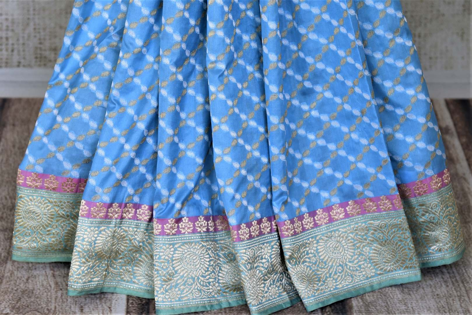 Shop gorgeous light blue Banarasi silk saree online in USA with golden zari border and pallu. Enhance your festive look with pure silk sarees, Banarasi saris, chanderi sarees in USA from Pure Elegance Indian clothing store in USA.-pleats