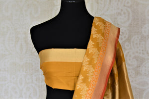 Shop gorgeous mustard Banarsi silk saree online in USA with overall golden zari work. Keep it elegant with zari work sarees, Banarasi silk sarees, handwoven sarees from Pure Elegance Indian fashion boutique in USA. We bring a especially curated collection of ethnic sarees for Indian women in USA under one roof!-blouse pallu