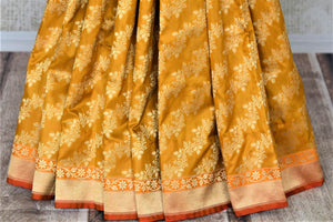 Shop gorgeous mustard Banarsi silk saree online in USA with overall golden zari work. Keep it elegant with zari work sarees, Banarasi silk sarees, handwoven sarees from Pure Elegance Indian fashion boutique in USA. We bring a especially curated collection of ethnic sarees for Indian women in USA under one roof!-pleats