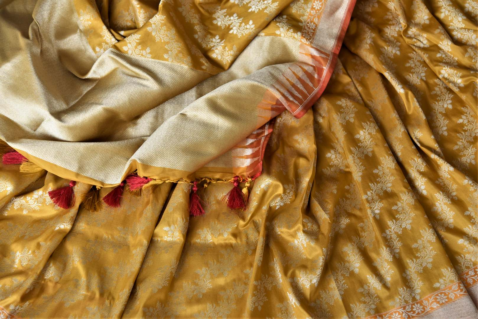 Shop gorgeous mustard Banarsi silk saree online in USA with overall golden zari work. Keep it elegant with zari work sarees, Banarasi silk sarees, handwoven sarees from Pure Elegance Indian fashion boutique in USA. We bring a especially curated collection of ethnic sarees for Indian women in USA under one roof!-details