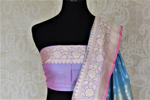 Shop stunning light blue Banarasi silk saree online in USA with silver zari buta and zari border. Keep it elegant with zari work sarees, Banarasi silk sarees, handwoven sarees from Pure Elegance Indian fashion boutique in USA. We bring a especially curated collection of ethnic sarees for Indian women in USA under one roof!-blouse pallu