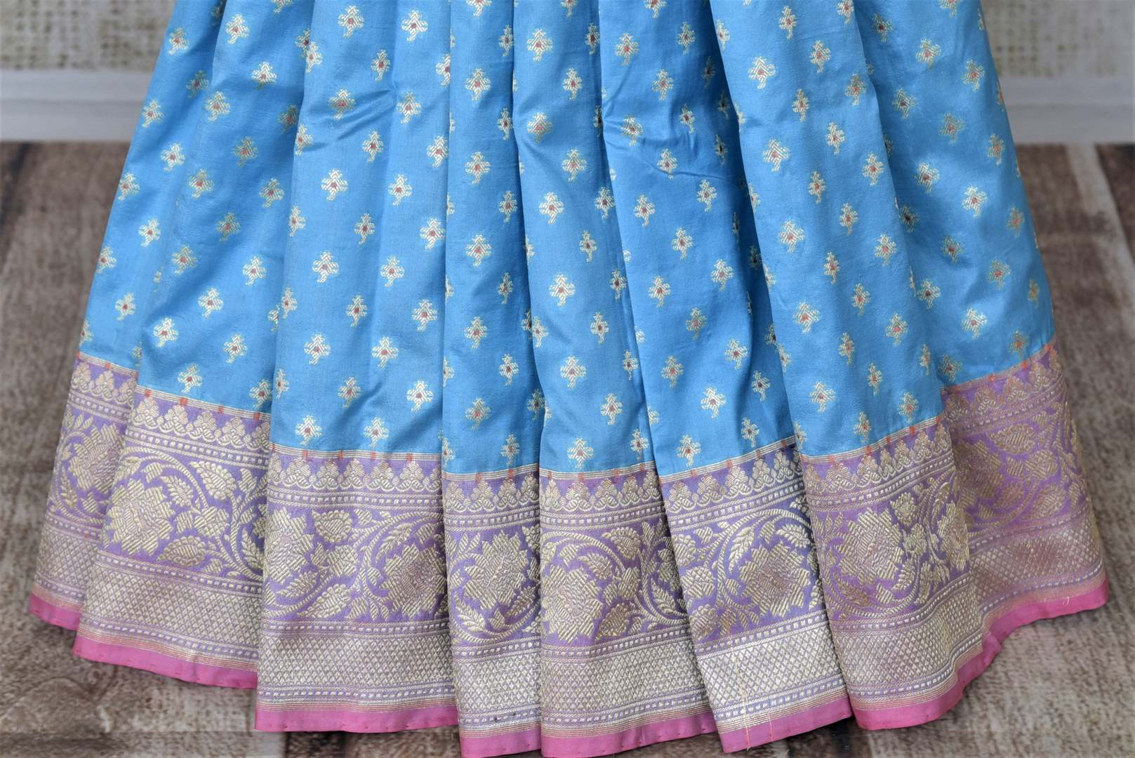 Shop stunning light blue Banarasi silk saree online in USA with silver zari buta and zari border. Keep it elegant with zari work sarees, Banarasi silk sarees, handwoven sarees from Pure Elegance Indian fashion boutique in USA. We bring a especially curated collection of ethnic sarees for Indian women in USA under one roof!-pleats