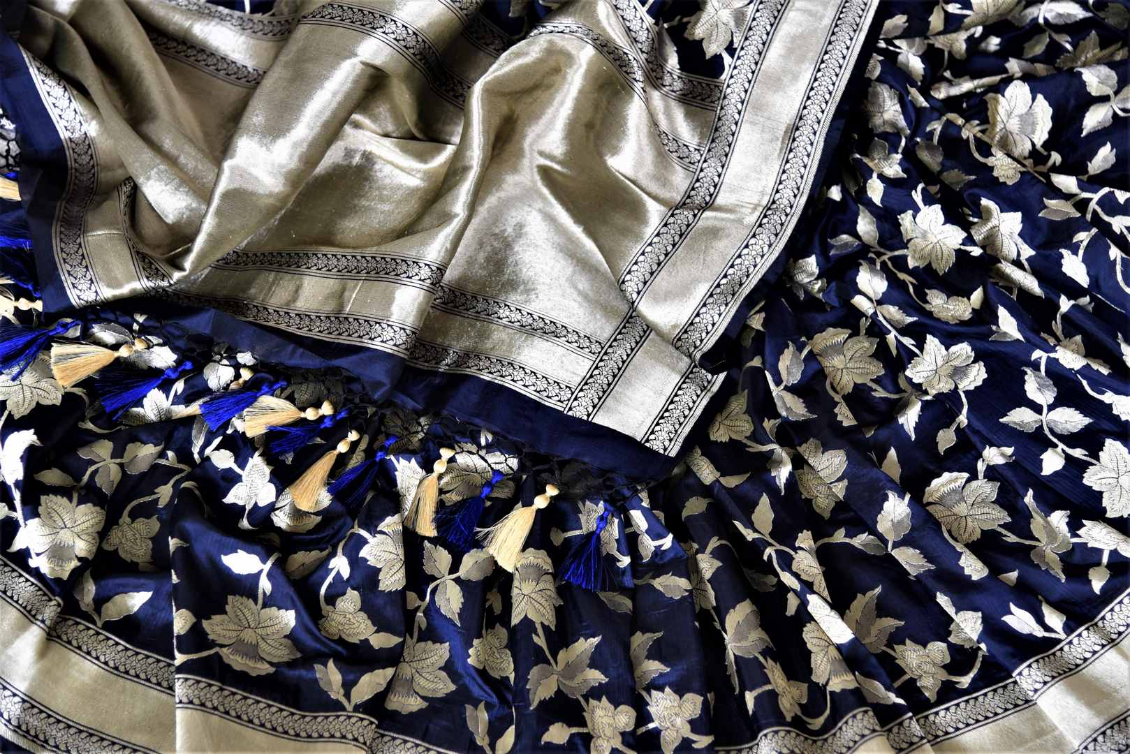 Shop beautiful navy Banarasi silk saree online in USA with floral zari work. Keep it elegant with zari work sarees, Banarasi silk sarees, handwoven sarees from Pure Elegance Indian fashion boutique in USA. We bring a especially curated collection of ethnic sarees for Indian women in USA under one roof!-details
