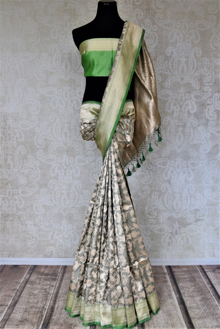 Shop beautiful light grey Banarasi silk saree online in USA with zari work green border. Keep it elegant with zari work sarees, Banarasi silk sarees, handwoven sarees from Pure Elegance Indian fashion boutique in USA. We bring a especially curated collection of ethnic sarees for Indian women in USA under one roof!-full view