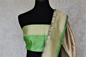 Shop beautiful light grey Banarasi silk saree online in USA with zari work green border. Keep it elegant with zari work sarees, Banarasi silk sarees, handwoven sarees from Pure Elegance Indian fashion boutique in USA. We bring a especially curated collection of ethnic sarees for Indian women in USA under one roof!-blouse pallu