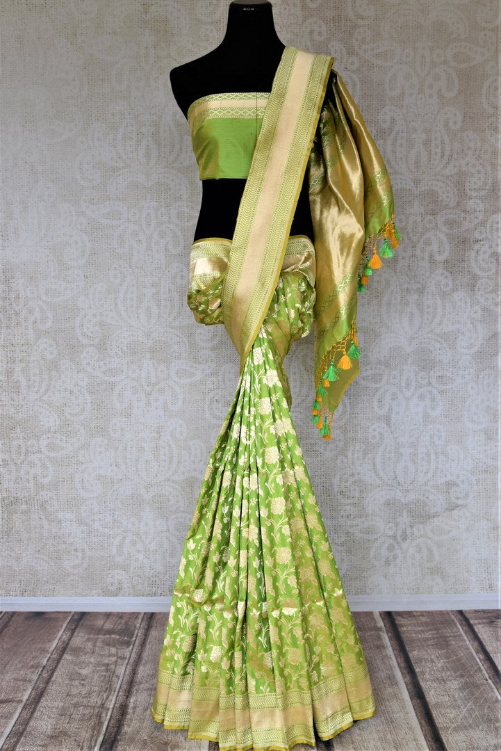 Shop attractive light green Benarasi silk saree online in USA with golden zari work. Keep it elegant with zari work sarees, Banarasi silk sarees, handwoven sarees from Pure Elegance Indian fashion boutique in USA. We bring a especially curated collection of ethnic sarees for Indian women in USA under one roof!-full view
