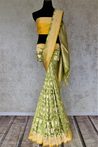 Buy stunning pista green Banarasi silk sari online in USA with zari work yellow border. Keep it elegant with zari work sarees, Banarasi silk sarees, handwoven sarees from Pure Elegance Indian fashion boutique in USA. We bring a especially curated collection of ethnic sarees for Indian women in USA under one roof!-full view