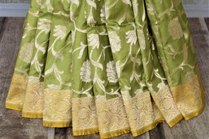 Buy stunning pista green Banarasi silk sari online in USA with zari work yellow border. Keep it elegant with zari work sarees, Banarasi silk sarees, handwoven sarees from Pure Elegance Indian fashion boutique in USA. We bring a especially curated collection of ethnic sarees for Indian women in USA under one roof!-pleats