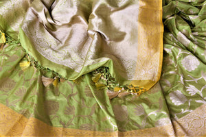 Buy stunning pista green Banarasi silk sari online in USA with zari work yellow border. Keep it elegant with zari work sarees, Banarasi silk sarees, handwoven sarees from Pure Elegance Indian fashion boutique in USA. We bring a especially curated collection of ethnic sarees for Indian women in USA under one roof!-details