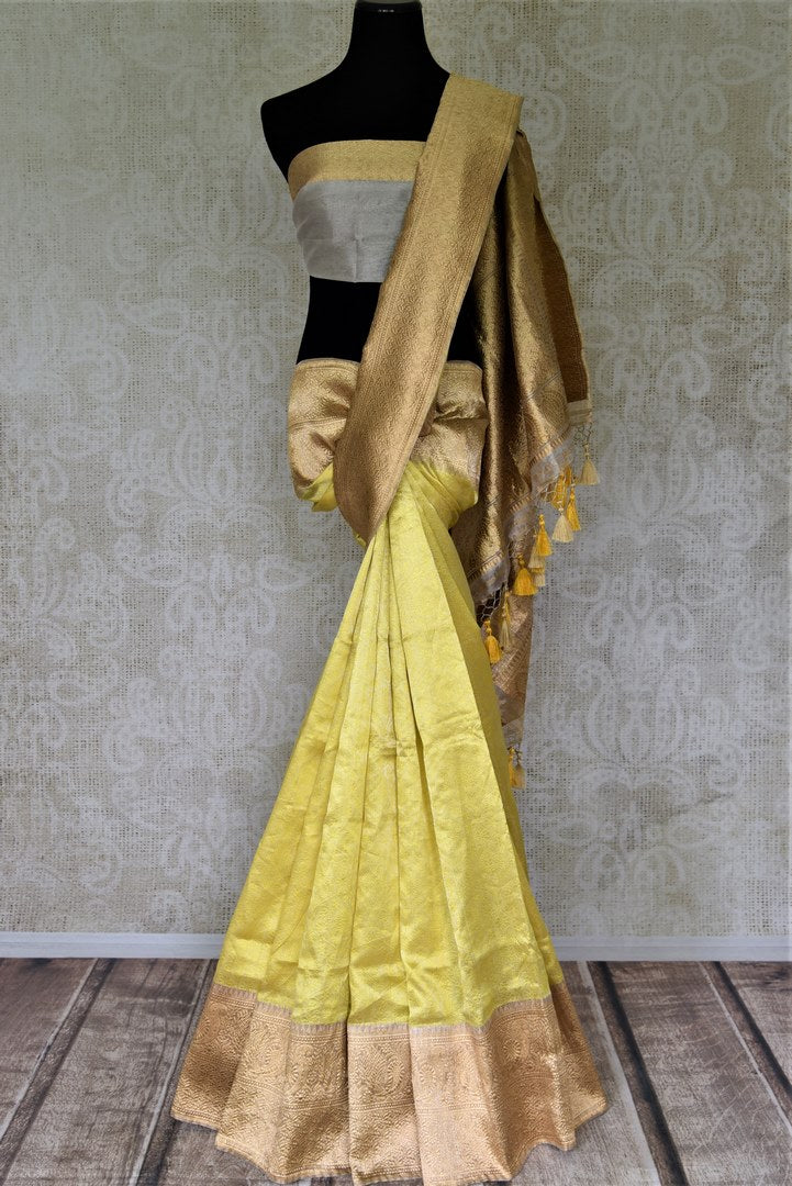 Buy stunning lemon yellow Banarasi silk sari online in USA with golden zari border and pallu. Enhance your festive look with pure silk sarees, Banarasi saris, chanderi sarees in USA from Pure Elegance Indian clothing store in USA.-full view