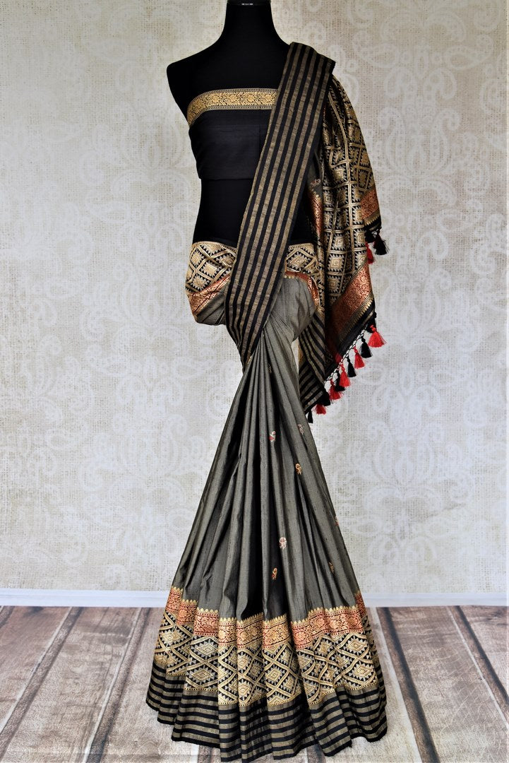 Buy gorgeous grey Banarasi silk sari online in USA with heavy zari border. For Indian women in USA, Pure Elegance Indian fashion store brings an exquisite collection Banarasi sarees, Banarasi silk sarees, tussar sarees, zari work sarees, pure silk sarees all under one roof. Shop online now.-full view