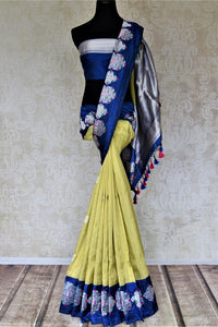 Buy beautiful pistachio green Banarasi silk sari online in USA with silver zari motifs on blue border. For Indian women in USA, Pure Elegance Indian fashion store brings an exquisite collection Banarasi sarees, Banarasi silk sarees, tussar sarees, zari work sarees, pure silk sarees all under one roof. Shop online now.-full view