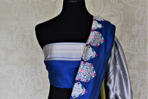 Buy beautiful pistachio green Banarasi silk sari online in USA with silver zari motifs on blue border. For Indian women in USA, Pure Elegance Indian fashion store brings an exquisite collection Banarasi sarees, Banarasi silk sarees, tussar sarees, zari work sarees, pure silk sarees all under one roof. Shop online now.-blouse pallu