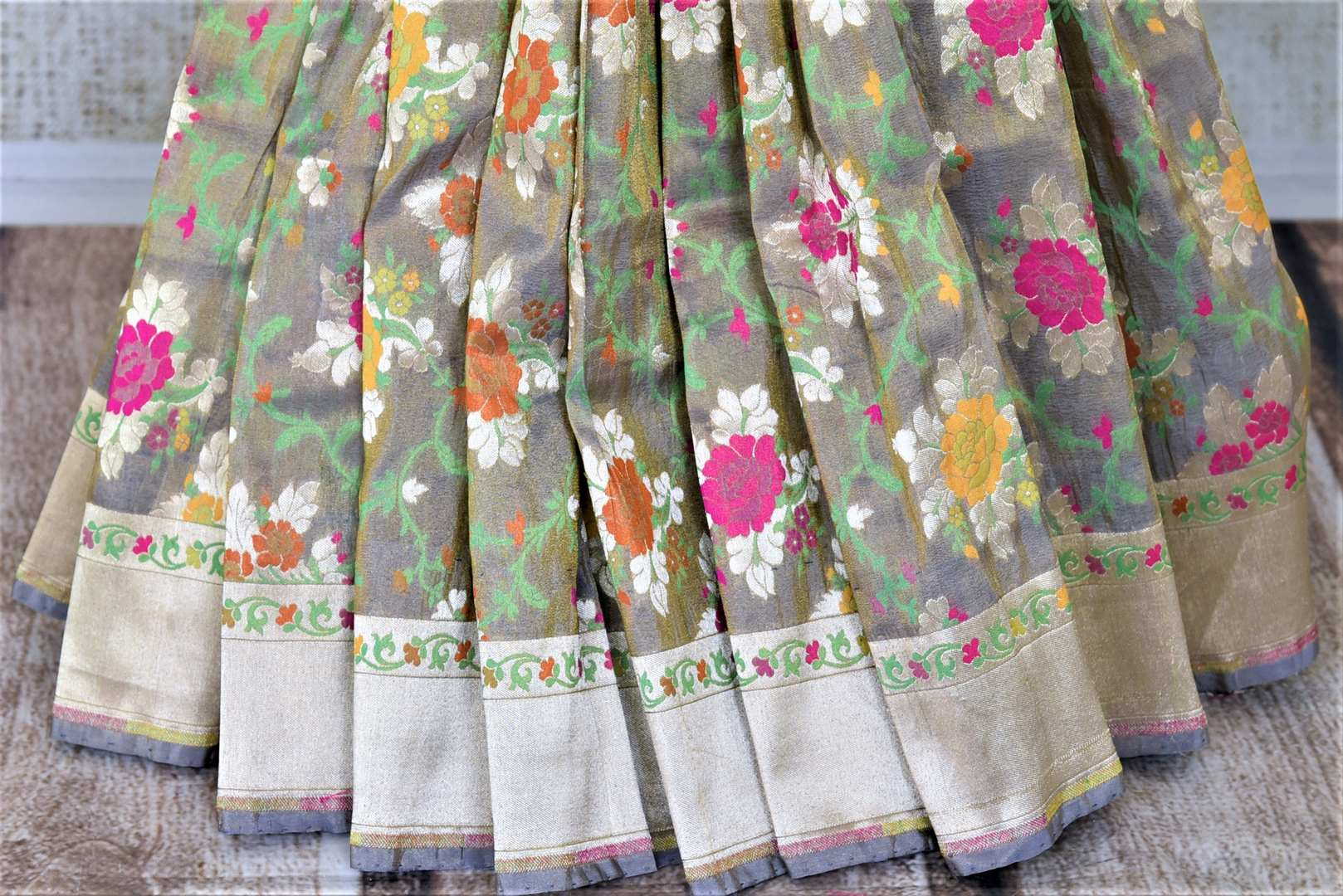 Buy gorgeous grey color Banarasi silk sari online in USA with floral minakari zari work. Enhance your festive look with pure silk sarees, Banarasi saris, chanderi sarees in USA from Pure Elegance Indian clothing store in USA.-pleats