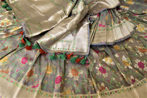 Buy gorgeous grey color Banarasi silk sari online in USA with floral minakari zari work. Enhance your festive look with pure silk sarees, Banarasi saris, chanderi sarees in USA from Pure Elegance Indian clothing store in USA.-details
