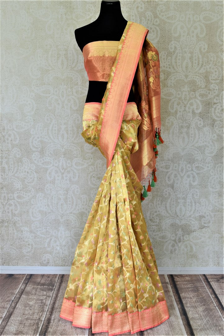 Buy attractive golden Banarasi silk sari online in USA with pink zari border and pallu. Enhance your festive look with pure silk sarees, Banarasi saris, chanderi sarees in USA from Pure Elegance Indian clothing store in USA.-full view