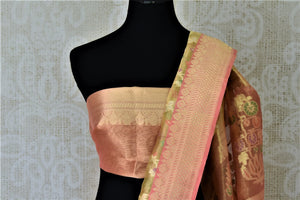 Buy attractive golden Banarasi silk sari online in USA with pink zari border and pallu. Enhance your festive look with pure silk sarees, Banarasi saris, chanderi sarees in USA from Pure Elegance Indian clothing store in USA.-blouse pallu