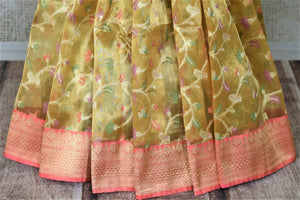 Buy attractive golden Banarasi silk sari online in USA with pink zari border and pallu. Enhance your festive look with pure silk sarees, Banarasi saris, chanderi sarees in USA from Pure Elegance Indian clothing store in USA.-pleats