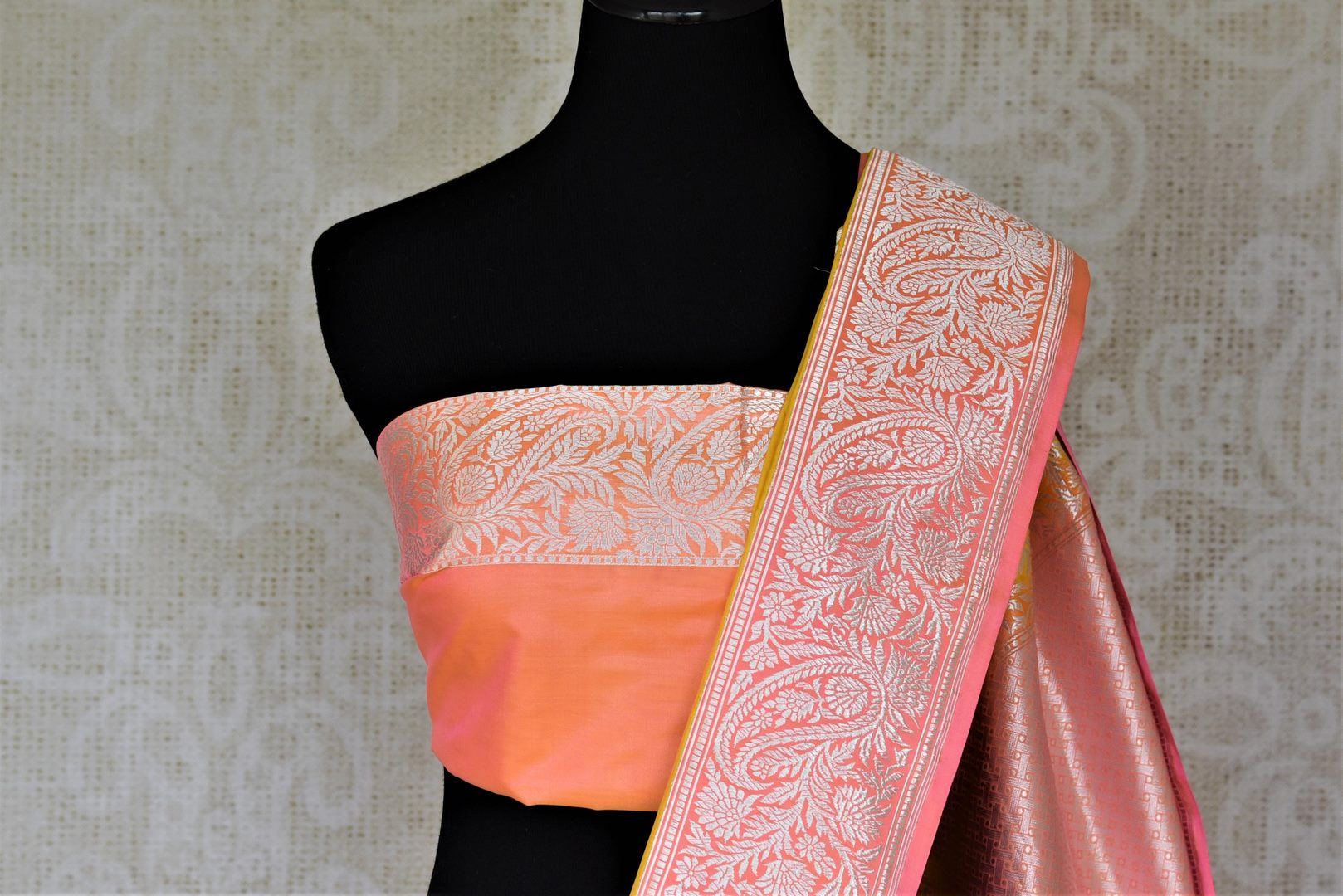 Buy charming yellow Banarasi silk saree online in USA with silver zari work on pink border. For Indian women in USA, Pure Elegance Indian fashion store brings an exquisite collection Banarasi sarees, Banarasi silk sarees, tussar sarees, zari work sarees, pure silk sarees all under one roof. Shop online now.-blouse pallu