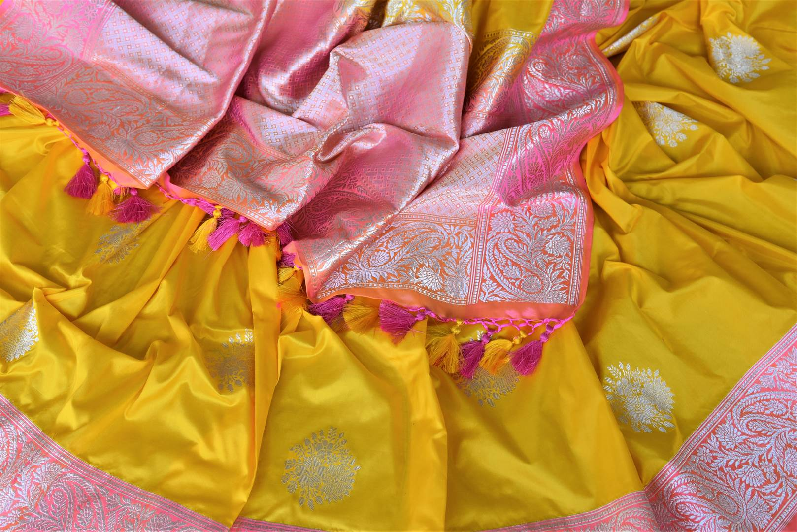 Buy charming yellow Banarasi silk saree online in USA with silver zari work on pink border. For Indian women in USA, Pure Elegance Indian fashion store brings an exquisite collection Banarasi sarees, Banarasi silk sarees, tussar sarees, zari work sarees, pure silk sarees all under one roof. Shop online now.-details