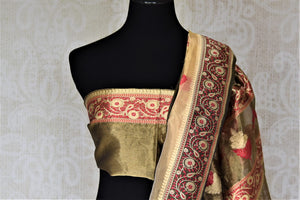Buy gorgeous golden tissue zari Banarasi saree online in USA with floral zari border. For Indian women in USA, Pure Elegance Indian fashion store brings an exquisite collection Banarasi sarees, Banarasi silk sarees, tussar sarees, zari work sarees, pure silk sarees all under one roof. Shop online now.-blouse pallu