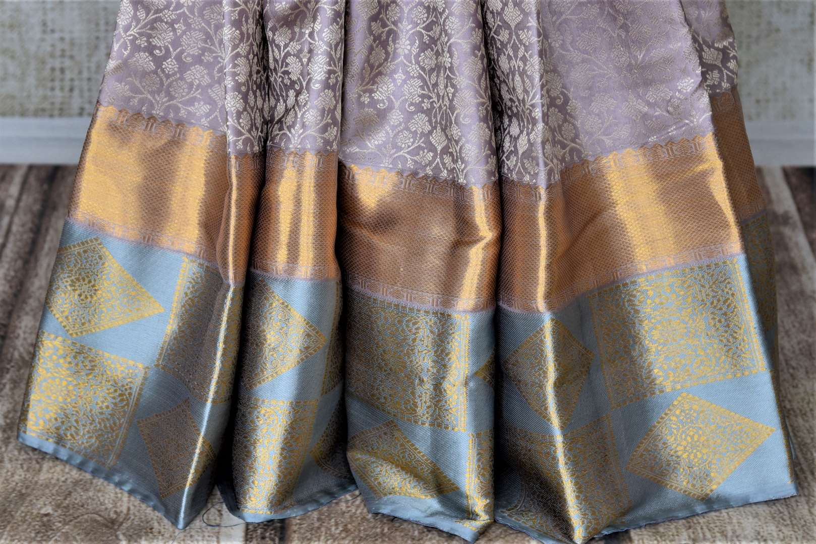 Shop beautiful grey Kanjeevaram saree online in USA with blue border. Look rich and traditional in zari work sarees, Kanchipuram silk sarees, handwoven sarees from Pure Elegance Indian fashion boutique in USA. We bring a especially curated collection of ethnic sarees for Indian women in USA under one roof!-pleats
