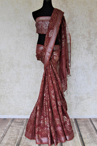 Shop stunning maroon color foil print linen sari online in USA. Keep it light yet festive on special occasions with beautiful handwoven saris, linen sarees from Pure Elegance Indian fashion store in USA.-full view