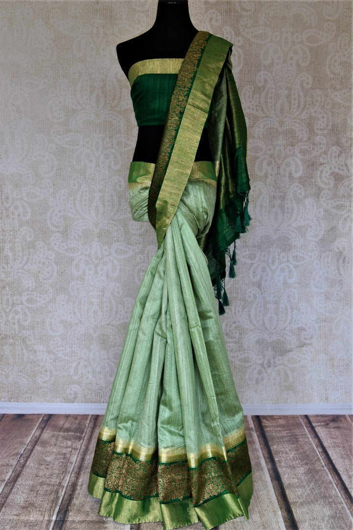 Shop dark green tussar Banarsi saree online in USA with green zari border. Choose tasteful handloom sarees for special occasions from Pure Elegance. Our exclusive Indian fashion store has a myriad of exquisite pure silk saris, tussar sarees, Banarasi sarees for Indian women in USA.-full view