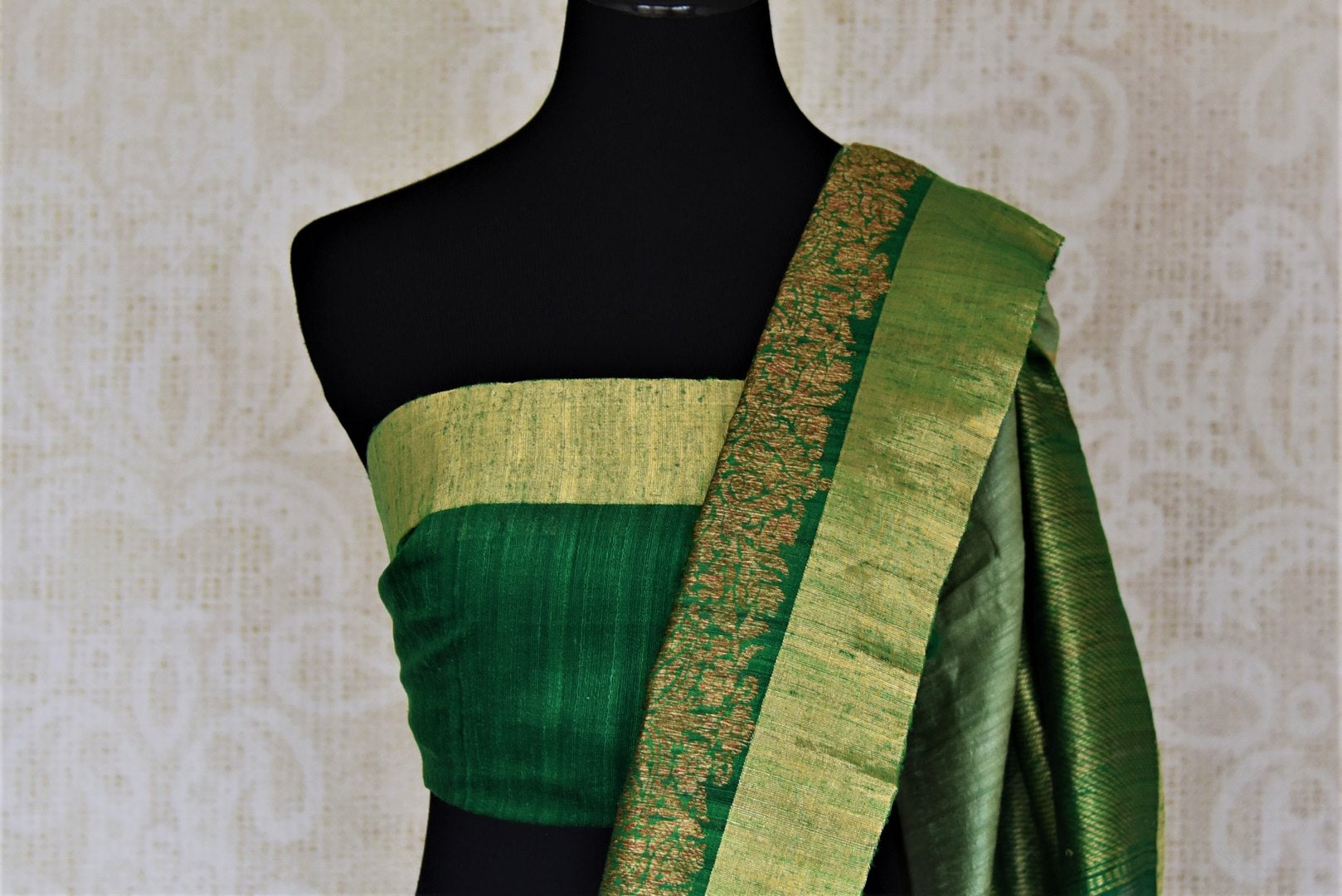 Shop dark green tussar Banarsi saree online in USA with green zari border. Choose tasteful handloom sarees for special occasions from Pure Elegance. Our exclusive Indian fashion store has a myriad of exquisite pure silk saris, tussar sarees, Banarasi sarees for Indian women in USA.-blouse pallu