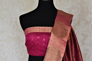 Buy beautiful orange tussar Banarsi sari online in USA with pink zari buta border. Choose tasteful handloom sarees for special occasions from Pure Elegance. Our exclusive Indian fashion store has a myriad of exquisite pure silk saris, tussar sarees, Banarasi sarees for Indian women in USA.-blouse pallu