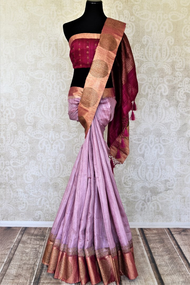 Buy beautiful lavender color tussar Banarasi saree online in USA with golden zari buta border. Be the center of attraction at weddings and parties with beautiful silk sarees, tussar sarees, embroidered sarees, partywear sarees, fancy sarees from Pure Elegance Indian fashion store in USA. -full view