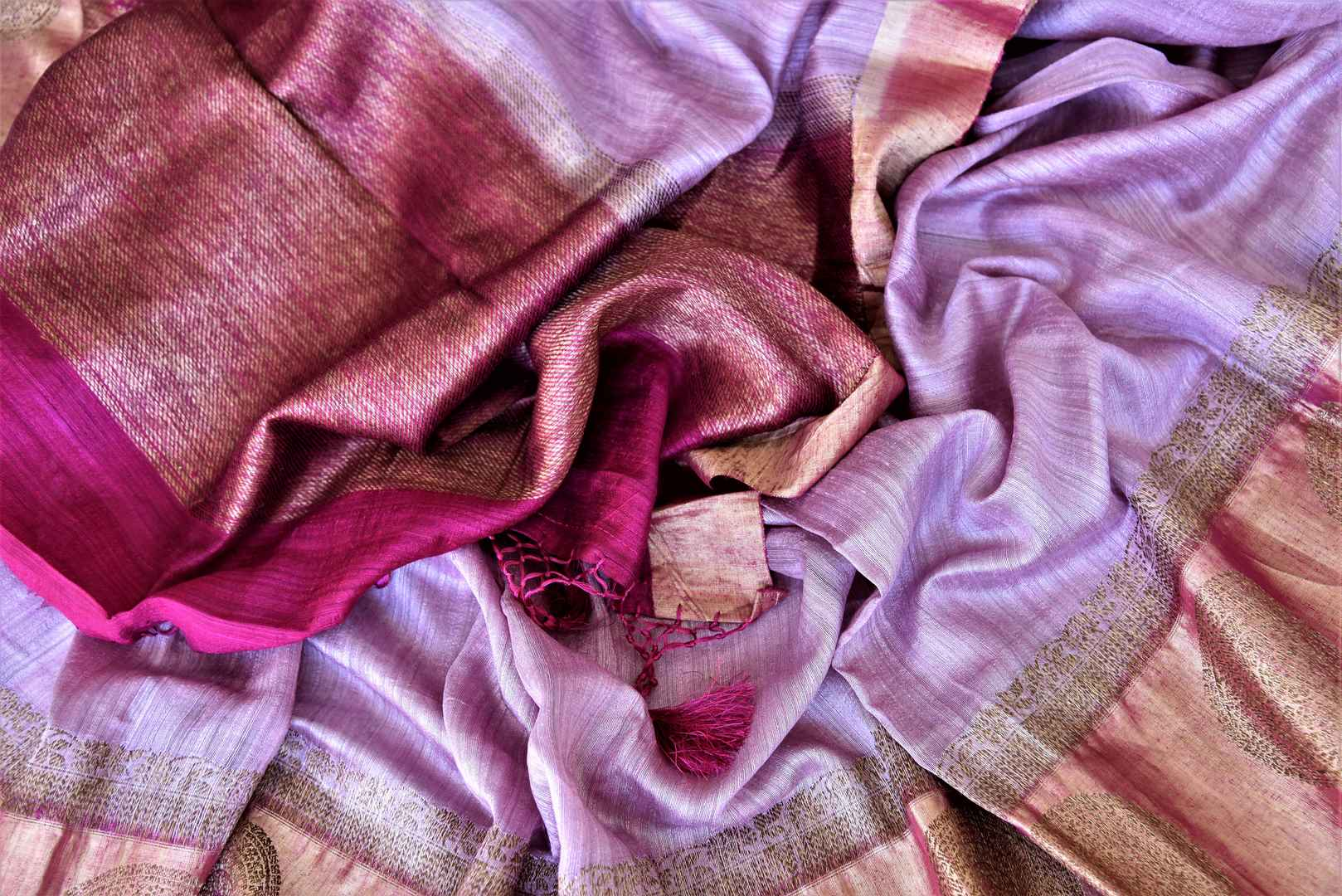 Buy beautiful lavender color tussar Banarasi saree online in USA with golden zari buta border. Be the center of attraction at weddings and parties with beautiful silk sarees, tussar sarees, embroidered sarees, partywear sarees, fancy sarees from Pure Elegance Indian fashion store in USA. -details