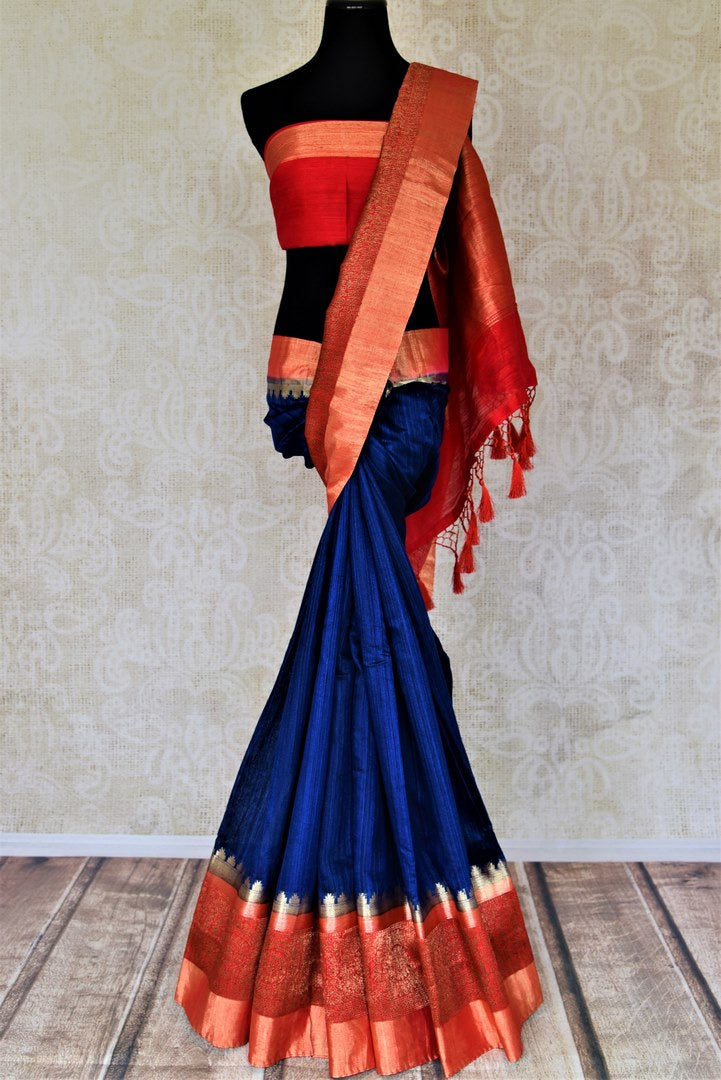 Shop ink blue tussar Banarsi saree online in USA with red zari border. Choose tasteful handloom sarees for special occasions from Pure Elegance. Our exclusive Indian fashion store has a myriad of exquisite pure silk saris, tussar sarees, Banarasi sarees for Indian women in USA.-full view