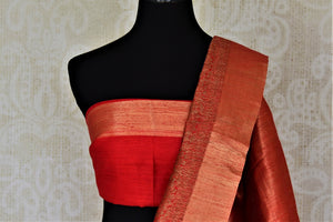 Shop ink blue tussar Banarsi saree online in USA with red zari border. Choose tasteful handloom sarees for special occasions from Pure Elegance. Our exclusive Indian fashion store has a myriad of exquisite pure silk saris, tussar sarees, Banarasi sarees for Indian women in USA.-blouse pallu