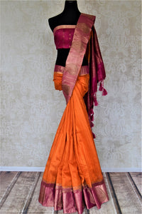Shop stunning orange tussar Banarsi saree online in USA with zari work on pink border. Choose tasteful handloom sarees for special occasions from Pure Elegance. Our exclusive Indian fashion store has a myriad of exquisite pure silk saris, tussar sarees, Banarasi sarees for Indian women in USA.-full view