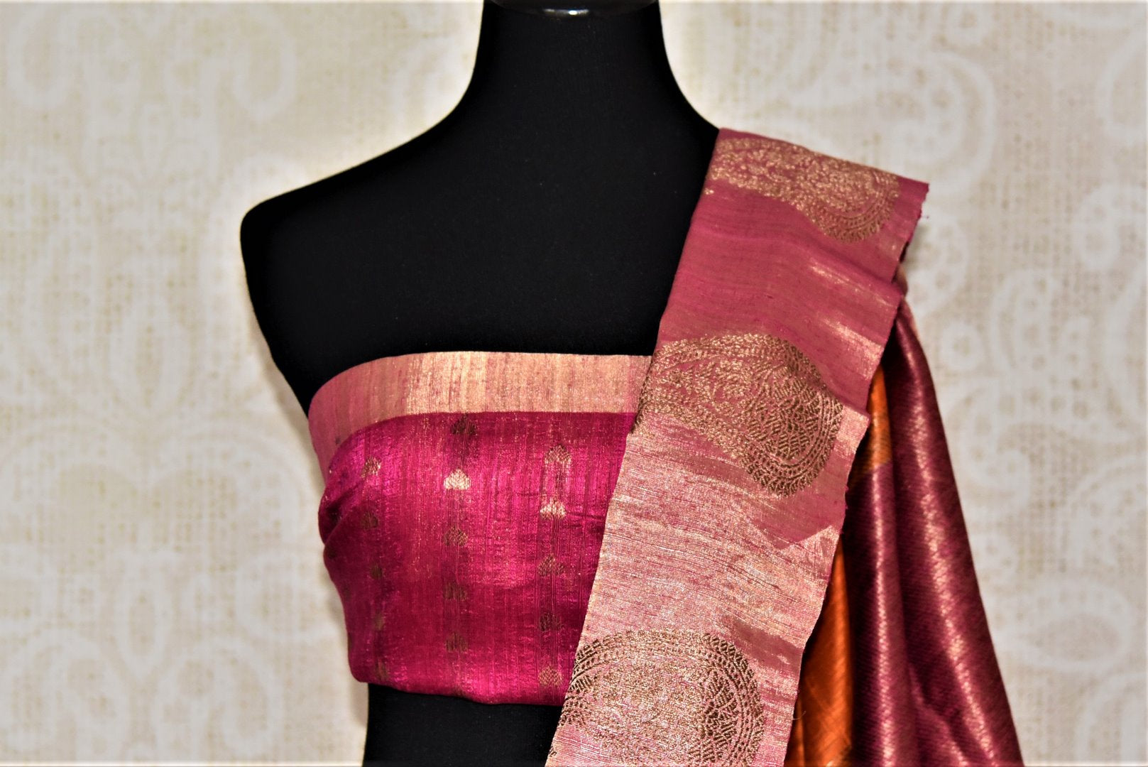 Shop stunning orange tussar Banarsi saree online in USA with zari work on pink border. Choose tasteful handloom sarees for special occasions from Pure Elegance. Our exclusive Indian fashion store has a myriad of exquisite pure silk saris, tussar sarees, Banarasi sarees for Indian women in USA.-blouse pallu