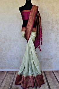 Shop mint green tussar Benarasi saree online in USA with magenta antique zari border. Keep your ethnic style updated with latest designer saris, handloom sarees, pure silk sarees from Pure Elegance Indian fashion store in USA.-full view