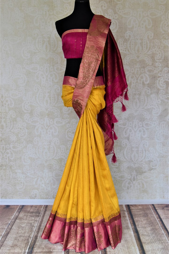 Buy bright yellow tussar Banarsi saree online in USA with zari work on pink border. Choose tasteful handloom sarees for special occasions from Pure Elegance. Our exclusive Indian fashion store has a myriad of exquisite pure silk saris, tussar sarees, Banarasi sarees for Indian women in USA.-full view