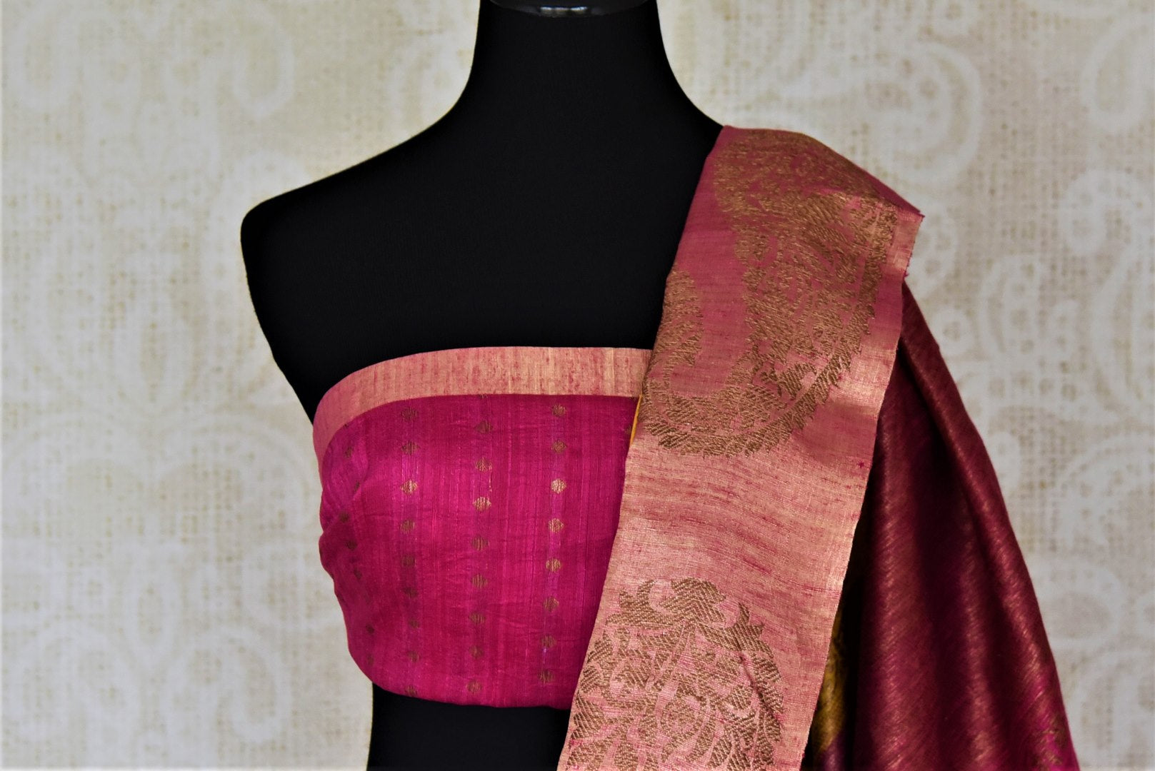 Buy bright yellow tussar Banarsi saree online in USA with zari work on pink border. Choose tasteful handloom sarees for special occasions from Pure Elegance. Our exclusive Indian fashion store has a myriad of exquisite pure silk saris, tussar sarees, Banarasi sarees for Indian women in USA.-blouse pallu