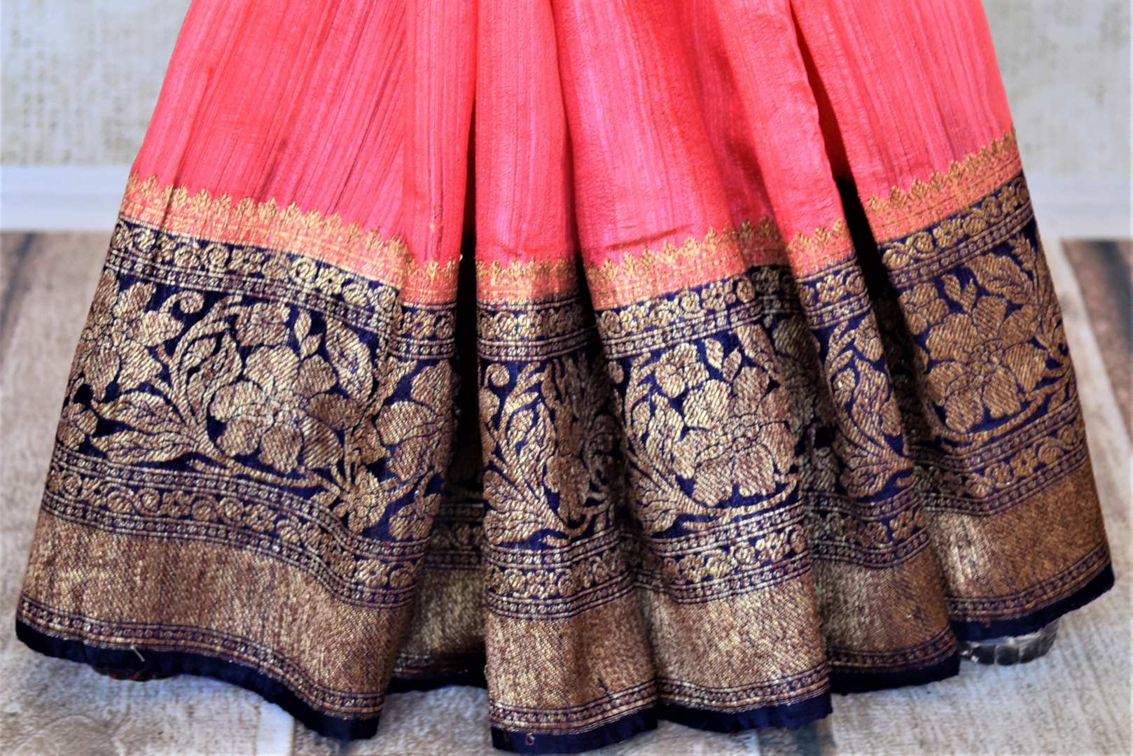 Buy bright pink tussar Benarasi saree online in USA with navy blue antique zari border. Keep your ethnic style updated with latest designer saris, handloom sarees, pure silk sarees from Pure Elegance Indian fashion store in USA.-pleats