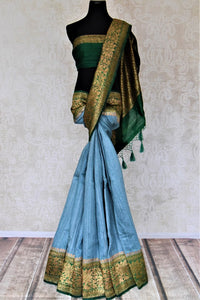 Buy lovely blue tussar Benarasi saree online in USA with green antique zari border. Keep your ethnic style updated with latest designer saris, handloom sarees, pure silk sarees from Pure Elegance Indian fashion store in USA.-full view