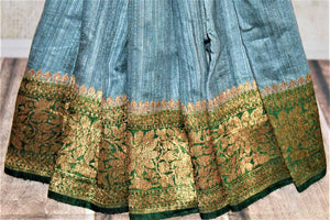 Buy lovely blue tussar Benarasi saree online in USA with green antique zari border. Keep your ethnic style updated with latest designer saris, handloom sarees, pure silk sarees from Pure Elegance Indian fashion store in USA.-pleats