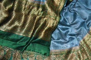 Buy lovely blue tussar Benarasi saree online in USA with green antique zari border. Keep your ethnic style updated with latest designer saris, handloom sarees, pure silk sarees from Pure Elegance Indian fashion store in USA.-details