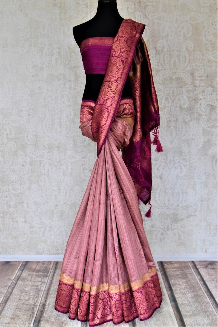 Buy beautiful dusty pink tussar Benarasi sari online in USA with magenta antique zari border. Keep your ethnic style updated with latest designer saris, handloom sarees, pure silk sarees from Pure Elegance Indian fashion store in USA.-full view