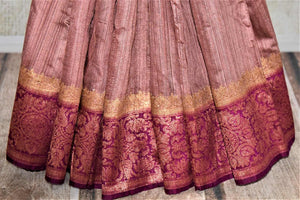 Buy beautiful dusty pink tussar Benarasi sari online in USA with magenta antique zari border. Keep your ethnic style updated with latest designer saris, handloom sarees, pure silk sarees from Pure Elegance Indian fashion store in USA.-pleats