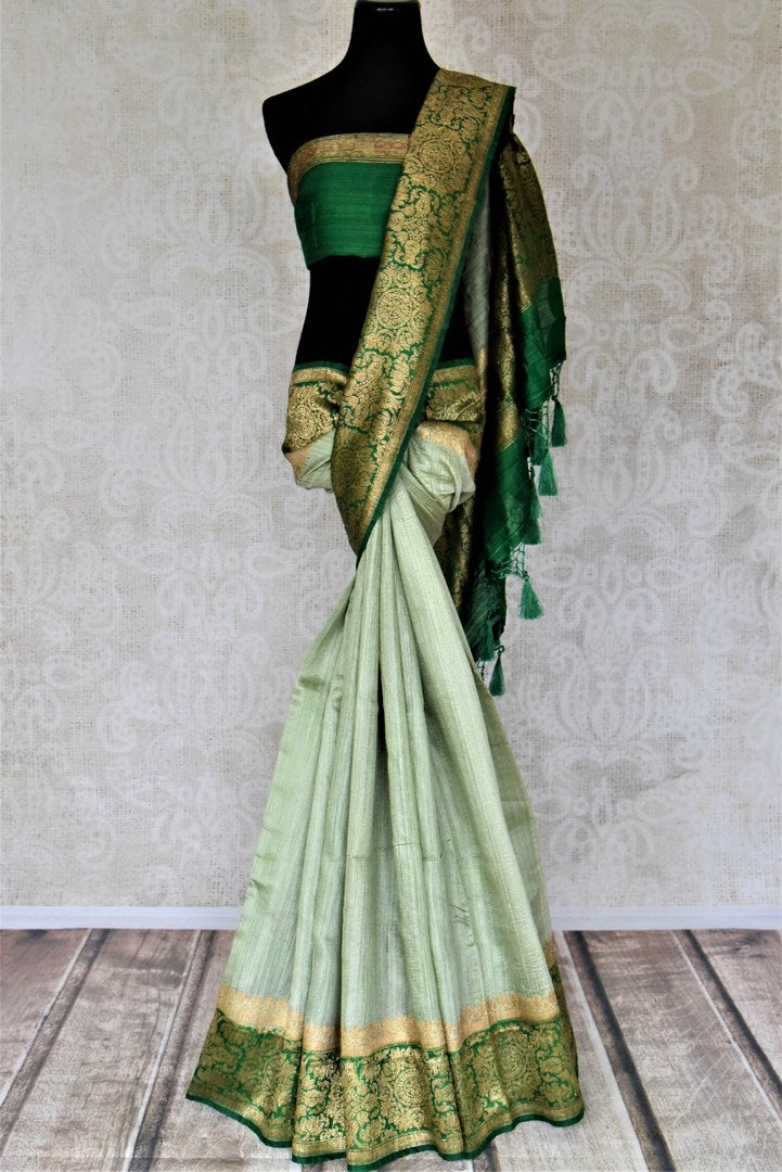 Shop mint green tussar Banarasi sari online in USA with green antique zari border. Keep your ethnic style updated with latest designer saris, handloom sarees, pure silk sarees from Pure Elegance Indian fashion store in USA.-full view