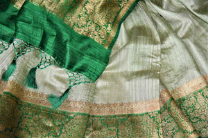 Shop mint green tussar Banarasi sari online in USA with green antique zari border. Keep your ethnic style updated with latest designer saris, handloom sarees, pure silk sarees from Pure Elegance Indian fashion store in USA.-details