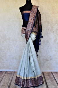 Shop elegant powder blue tussar Benarasi sari online in USA with dark blue antique zari border. Keep your ethnic style updated with latest designer saris, handloom sarees, pure silk sarees from Pure Elegance Indian fashion store in USA.-full view