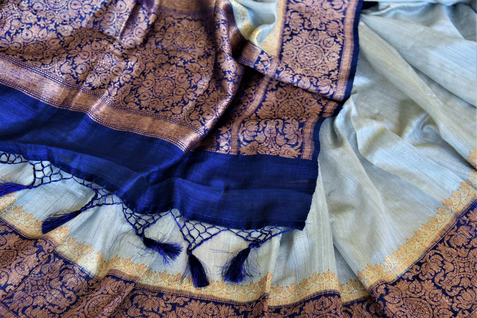 Shop elegant powder blue tussar Benarasi sari online in USA with dark blue antique zari border. Keep your ethnic style updated with latest designer saris, handloom sarees, pure silk sarees from Pure Elegance Indian fashion store in USA.-details